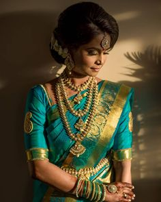 South Indian bride. Gold Indian bridal jewelry.Temple jewelry. Jhumkis.Teal green silk kanchipuram sari.Braid with fresh jasmine flowers. Tamil bride. Telugu bride. Kannada bride. Hindu bride. Malayalee bride.Kerala bride.South Indian wedding. Pinterest: @deepa8