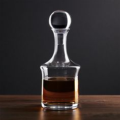 Handmade by master glassblowers, handsome glass whiskey decanter bottle stands out at the bar or buffet with dramatically tapered profile, thick sham and showy oversized stopper. Each meticulously crafted stopper is individually shaped, ground and polished for a custom fit.