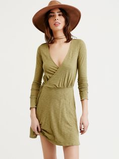 FREE PEOPLE Tiny Dancer Wrap Dress | Made from our semi-sheer Beach slub, this fit-and-flare wrap dress features a V-neck and long sleeves. Easy tie waist. Throw on top of a bikini or layer over one of our seamless styles for an effortless look. American made.