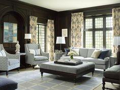 dark paneled walls with light furnishings