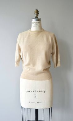 Vintage 1950s cream cashmere sweater with crew neckline and short sleeves. --- M E A S U R E M E N T S --- fits like: medium/large shoulder: 16 bust: 38-42 length: 21 brand/maker: cashmere, imported wool condition: excellent ➸ More tops & sweaters https://www.etsy.com/shop/DearGoldenVintage?section_id=5800171 ➸ Visit the shop http://www.DearGolden.etsy.com _____________________ ➸ instagram | deargolden ➸ twitter | deargolden ➸ facebook.com ...