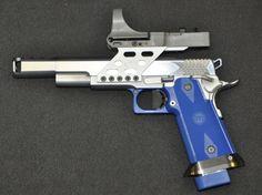 Gotta love a hand gun w/ a holographic sight