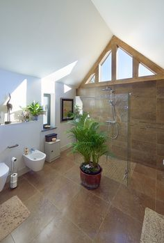 The bathroom has a very light, open and contemporary feel to it, with a beautiful tiled floor.