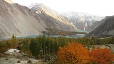 Gulmit valley: the headquarter of the Gojal Tehsil, and one of the old Wakhi settlement and historic town with high mountains, glaciers & peaks in the Karakoram range, in the province of Gilgit-Baltistan, northern area Pakistan. Across the river is Shishkat valley. Blue water in the middle of these two valley is the disaster lake (Atta Abad Lake).