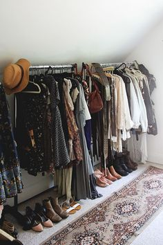Really like the idea of a long runner in front of the clothes rail