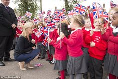 Cheers: Sophie also travelled to RAF Wittering where she was met by children from a local primary school