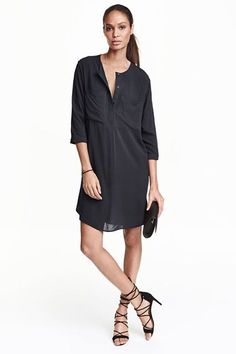 A minimal, sleek aesthetic is just what we look for in a little black dress. Style it over pants for a more relaxed feel, or jazz it up for nighttime with block heels and delicate jewelry.  #refinery29 http://www.refinery29.com/affordable-spring-dresses-hm#slide-2