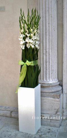 Fioreria Oltre/ Wedding ceremony/ Church wedding flowers/ Church door decoration/ White gladiolus  https://it.pinterest.com/fioreriaoltre/fioreria-oltre-wedding-ceremonies/