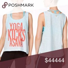 """Gaiam """"Yoga Kicks Asana"""" Graphic Tank For all the yogis out there, this tank is for you!Super cute and lightweight muscle tank in a beautiful sky blue featuring soft fabric that drapes into a great layering piece. Runs large. Scoop neckline with gold-tone charm at back Pullover styling Sleeveless Ombré dip-dyed slub fabric Breathable and quick-drying Graphic at front Raw finish Hits above hip Cotton/modal Gaiam Tops Tank Tops"""