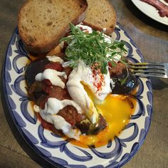 Gorgeous roasted eggplant, yogurt and stewed tomatoes with perfectly poached eggs