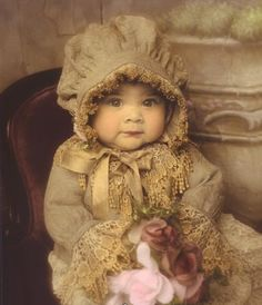 """Grandma sits on her pink cloud."" Little girl in old fashioned bonnet and dress…"