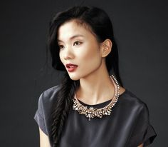 Model in silk charcoal top and statement necklace