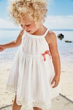 This little outfit has got us dreaming of the beach! Kit your little one out in cute sundresses like this.