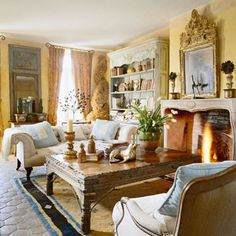 One way to add style and a personal touch to your living room is through the floors. Here, an area rug sits atop hexagonal tiles that set the tone for the rest of the room. The old-world style of the floors creates the perfect backdrop for fine antique pieces, such as the French-style coffee table in this living room.