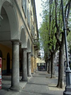 Saronno.  On a day trip from Milan to Como, stop in for a stroll down the noble-looking streets of Saronno.  Home to Di Saronno liqueur and Amaretti di Saronno cookies.