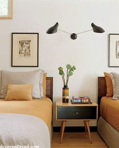 Q:I spotted this wonderful Scandinavian style wall sconce but can't locate it online. I would like to center this above our bed instead of using bedside lamps. It is similar to the Serge Mouille style lights but not quite.