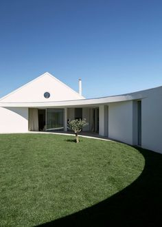 Influenced by the proportions of the golden ratio, Ansião House by Bruno Dias Arquitectura holds a circular courtyard at its centre, presenting a contemporary twist on the historic homes of Portugal's Leiria District.