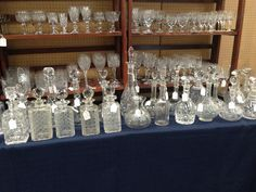 Glass decanters and glasses for sale at Newark antique fair.