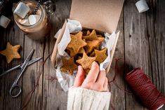 Traditional autumn winter drinks and treats. Cup of hot chocolate with marshmallow and ginger biscuit stars, in gift box, old rustic wooden table. Person takes cookies from box, top view copy space , Pizza Nutrition Facts, Nutrition Store, Nutrition Education, Nutrition Tips, Dark Chocolate Nutrition, Hot Chocolate, Balanced Diet Plan, Weight Loss Meal Plan