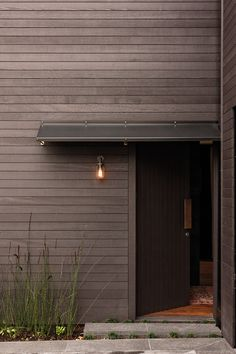 Horizontal grey stained timber cladding with extended porch - House designed by Bureaux in Auckland, New Zealand House Cladding, Timber Cladding, Exterior Design, Interior And Exterior, External Cladding, Balustrades, Dark House, Cedar Homes, House Extensions