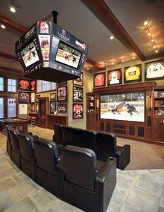 Totally awesome for a media room! All my husband's framed jerseys and sports memorabilia would look great!! Not to mention all that stuff could be in ONE room :-)