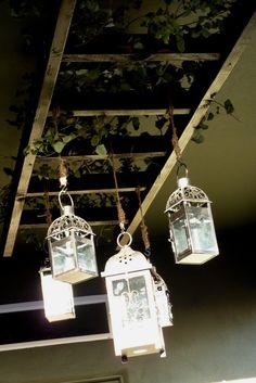 Hanging ladder with hanging lanterns strung from jute.
