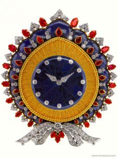 Bvlgari Bulgari table clock in gold and platinum with lapis lazuli, rubies and diamonds, 1968.