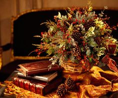 A vibrant basket arrangement of pinecones, evergreen, and berry sprigs