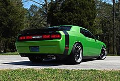 Why don't we see more green muscle cars? Adam's Snakeskin Green Petty's Garage #Dodge #Challenger SRT is powered by a Magnuson-supercharged 392 Hemi beneath a shaker hood and rides on Petty's Garage suspension and 20-inch #Forgeline #GA3 wheels finished with Satin Black centers & Polished outers! See more at: http://www.forgeline.com/customer_gallery_view.php?cvk=1372