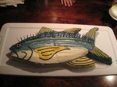 Tasty birthday cake shaped as a fish