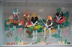Swimming/Underwater window display idea #floatie #tube #fish