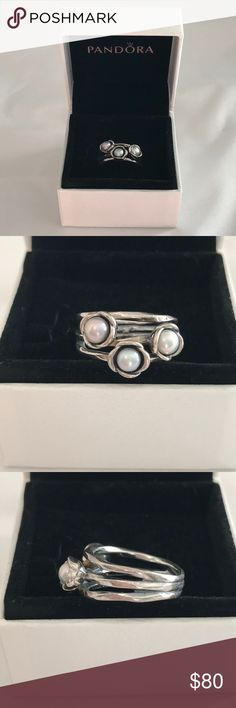 AUTHENTIC Pandora Triple Bloom ring Authentic Pandora with stamping. Sterling silver. Three pearls. Original box. Size 6. No longer in stores. Pandora Jewelry Rings