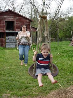 Repurposed tractor seat becomes swing or  zip-line chair for country farm fun.