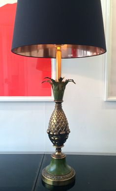 A large brass Pineapple lamp, with green enamelled base and finials. Base 80 cm high produced USA by Stiffel, c.1960S. Re-wired for UK with gold cord flex and PAT tested.
