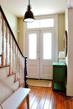 I like this entry way and the extra windows above the front doors.  Great wide plank floors, too.