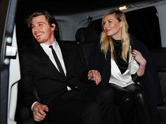 Kirsten Dunst and beau Garrett Hedlund make for one chic couple as they depart their hotel Monday in Paris, where the two later sat front row at Fashion Week for the Saint Laurent show.