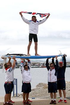 Great Britain's Nick Dempsey is lifted high on his windsurfer after winning the RS:X men Olympic silver medal on the waters off Weymouth