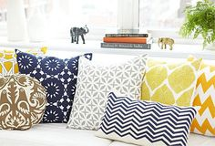 throw pillows by Allem Studio. I love the mixing of chevron and ikat prints.