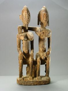 Dogon sculpture of a seated ancestor couple, Mali, 19th-20th century (wood)