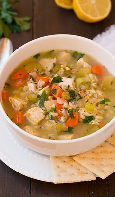 Delicious soup with chicken and vegetables cooked in slow cooker.