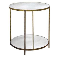 The Low Jonathan Side Table from Oly Studio is a simple metal base with a reverse beveled antique mirror top. *Shown in Antique Gold Base & Antique Mirror Priced as shown. Please call for other finish options. Prices may vary. Tall Accent Table, Tall Side Table, Mirrored Accent Table, Coffee Table Rectangle, Coffee Tables, Sofa Tables, Gold End Table, Round End Tables, Glass Top End Tables