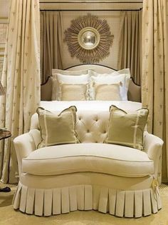 James Michael Howard.  I have the same  boudoir sofa by Hickory Chair Company upholstered in Kravet Fabric.