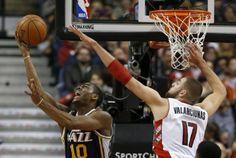 The Raptors' Jonas Valanciunas goes up to block a shot from Utah's Alec Burks during second-half play Saturday night. Photo by Rick Madonik/Toronto Star