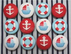 A nautical themed cake with edible Life Buoy, piped waves and alternating boat and anchor design around the side. Cupcakes made to match.