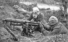 WW I English: British Vickers machine gun crew wearing PH-type anti-gas helmets. Near Ovillers during the Battle of the Somme, July 1916. The gunner is wearing a padded waistcoat, enabling him to carry the machine gun barrel. See Image:Vickers machine gun crew with gas masks rear view.jpg for an alternate view of this crew. File:Vickers machine gun crew with gas masks.jpg Public Domain