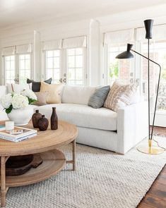 coastal living rooms A coastal, traditional living room with function and flow in mind! Coastal Living Rooms, Rugs In Living Room, Living Room Designs, Living Room With Beige Couch, Cream And White Living Room, Natural Living Rooms, Hamptons Living Room, Neutral Couch, Beach Living Room