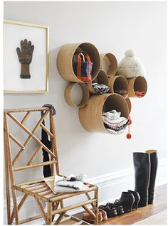 DIY cardboard tube shelves. Great for holding knick-nacks in an entry way.