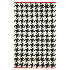 Flatweave wool rug with a houndstooth motif and contrasting border. Made in India.     Product: RugConstruction Material: ...