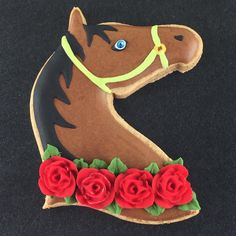 I'm heading to the Kentucky Derby later this week, and it wouldn't be a proper experience without decorated cookies!  This horse head is…
