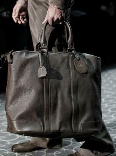 Gucci Mens Bags..first spotted by Barry Clemens...the story here is simple: this type of bag is so much more stylish than a roll-on.